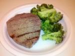 Steak with garlic salt, ground pepper, and broccoli