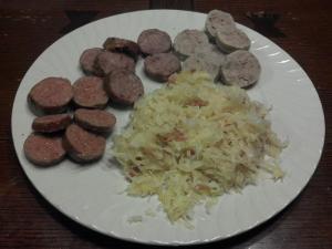 Bratwurst, hot link, and kielbasa with sauerkraut