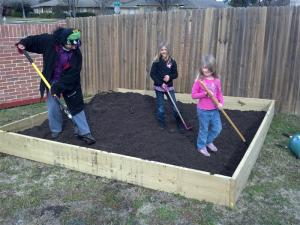 Leveling the dirt with my girls and a family friend